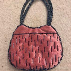Bloomingdales pink velvet and grey beaded bag.